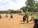 Volunteers Play Soccer with the Kids